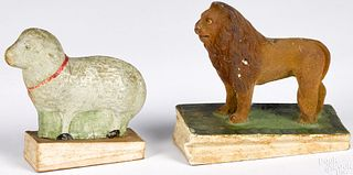Two lion and lamp pipsqueak toys, 19th c.