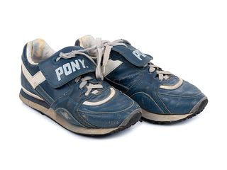 A Pair of Greg Maddux Game Used Pony Cleats,