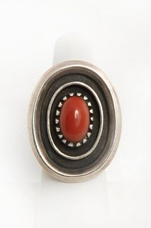 A Coral and Sterling Navajo Silver Ring