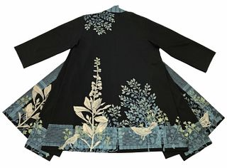 Black coat with plants, birds and a turquoise border design.