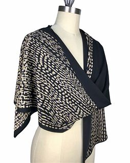 Black, blush and gold wrap with printed dots.