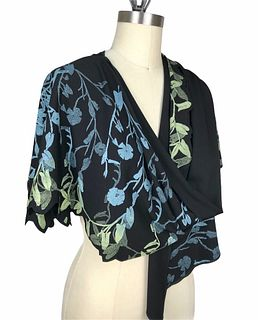 Black, turquoise and green wrap with vines.
