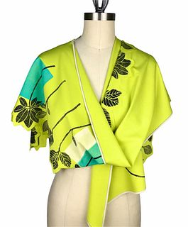 Bright green wrap with leaves and rectanlgles.