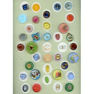 One Card Of Small/Medium Moonglow Glass Buttons