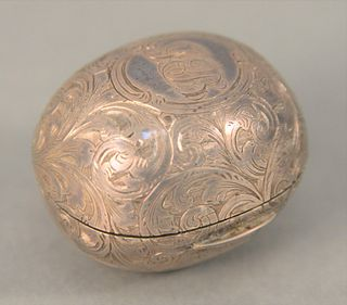 Continental Silver Nutmeg Grater, in the form of a nut, hallmarked H & T Birminghams, having etched foliate decoration with palm tre...