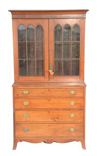 Federal Cherry two part cabinet/chest, upper section with two glazed doors on lower section having four drawers all set on French fe...