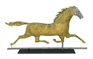 Running Horse Weathervane having zinc head, mane and tail flowing mostly gilt with some verdigris surface. height 17 1/2 inches, len...