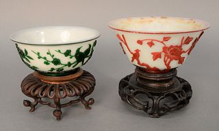Two Chinese Overlay Bowls, white glass having green overlay, carved birds and flowers and white glass with red overlay trees and bir...