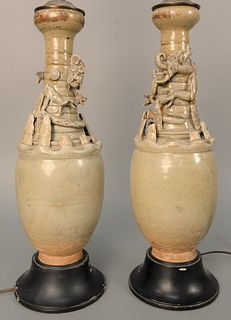 Pair of Chinese Funerary Vases with molded figures and dragons. vase height 16 1/2 inches, total height 30 1/2 inches. Provenance: A...