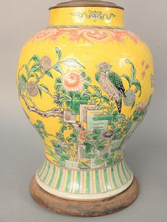 Chinese Porcelain Famille Rose Vase, yellow ground with painted blossoming tree and perched birds (repaired). height 13 1/4 inches, ...