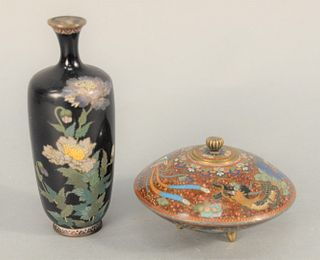 Two Japanese Cloisonne Pieces to include a vase having navy ground and sprays of purple and white flowers, and a lidded round box ha...