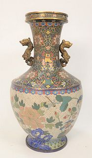 Large Cloisonne and Bronze Vase having blossoming lotus with scrolling flowers, birds and fish with brass foo dog handles. height 22...