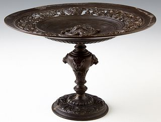 Patinated Bronze Baroque Style Tazza, early 20th c., the pierced concave top with a central relief Northwind face, on a tapered supp...