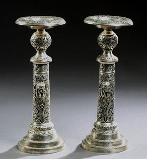 Pair of Large Silverplated Spelter Pricket Candlesticks, 20th c., the candle cup on a relief ball socle, atop a cylindrical support...