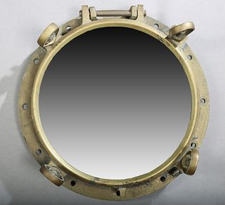 Solid Bronze Large Ship's Port Hole, 20th c., now mounted with a mirror, H.- 6 1/2 in., Dia.- 18 in.