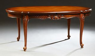 French Carved Cherry Louis XV Style Draw Leaf Dining Table, 20th c., the tortoise shaped parquetry inlaid top over a wide carved ski...