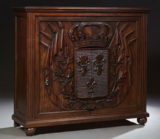French Carved Walnut Sideboard, 19th c., the stepped top over double relief carved doors with a crown over a fleur-de-lis carved shi...