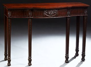 English Hepplewhite Style Carved Mahogany Bowfront Console Table, 20th c., with a central reeded drawer and skirt on tapered square...