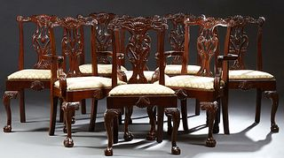 Set of Eight (6 +2) Carved Mahogany Chippendale Style Dining Chairs, the shell carved crest rail above a pierced backsplat, to a wid...