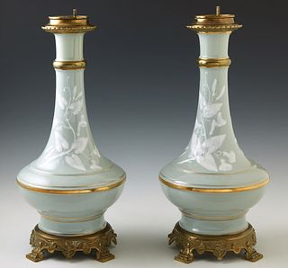 Pair of French Gilt Brass Mounted Pate Sur Pate Celadon Porcelain Oil Lamps, 19th c., of Baluster form, with relief floral and leaf...