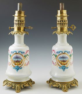 Pair of Old Paris Style Gilt Ormolu Mounted Porcelain Oil Lamps, 19th c., of baluster bottle form, with hand painted reserves of flo...