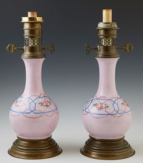 Pair of Old Paris Style Lavender Porcelain Bottle Form Oil Lamps, 19th c., with floral and polychromed decoration, on circular brass...