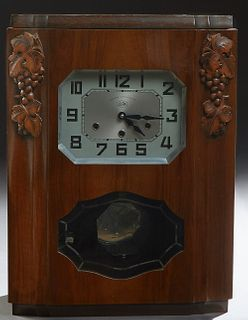 French Art Deco Carved Walnut Westminster Chiming Mantel Clock, c. 1930, by Jura, the octagonal steel face flanked by grape and leaf...