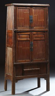Chinese Bamboo and Elm Kitchen Cabinet, early 20th c., the rounded edge rectangular crown over double bamboo mounted upper cupboard...
