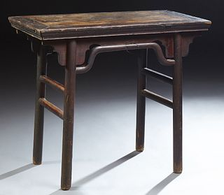 Chinese Mu Wood Wine Table, 19th c., the rectangular top on pierced curved bracket supports, to cylindrical legs joined by a stretche..