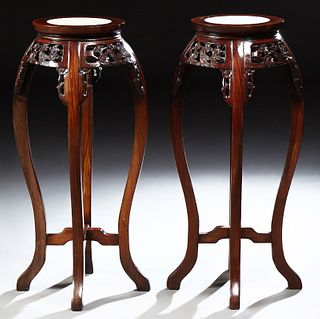 Pair of Chinese Carved Mahogany Marble Top Pedestals, 20th c., the inset circular marble over a pierced skirt with bird and floral d...