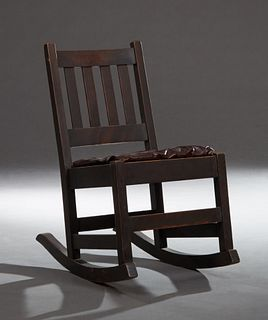 Mission Oak Lady's Rocker, in the manner of Gustav Stickley, early 20th c., the slatted back over a cushioned seat, on square block...