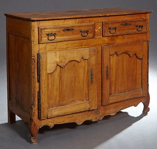 French Provincial Louis XV Style Carved Cherry Sideboard, c. 1850, the rectangular canted corner top over two frieze drawers above d...