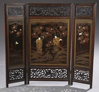Chinese Three Panel Table Screen, 19th c., with pierce carved tops with birds and leaves, over gilt decorated black lacquer panels w...