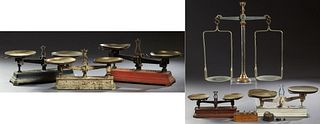 Six French Balance Scales, 19th c., consisting of five cast iron double beam balance scales and a large brass and iron balance scale...