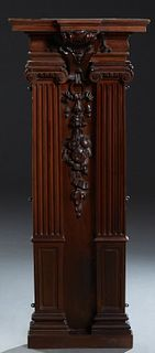 Victorian Carved Walnut Architectural Element, 19th c., the breakfront stepped crown over a shield flanked by engaged Ionic tapered...