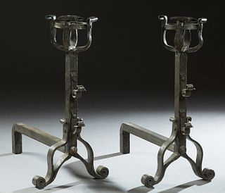 Pair of Large French Medieval Style Wrought Iron Andirons, 19th c., with pierced curved bow tops on square supports with tool hooks,...