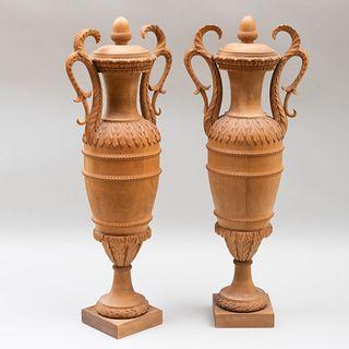 Pair of Continental Classical Limewood Vases and Covers