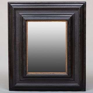 Large Flemish Baroque Style Ebonized and Parcel-Gilt Mirror