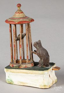 Cat and bird in cage pipsqueak toy, 19th c.
