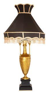 EGYPTIAN-REVIVAL GILT-BRONZE LAMP WITH BLACK SILK SHADE, 19TH CENTURY