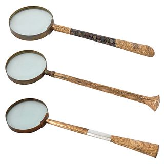 A SET OF THREE VICTORIAN BRASS MAGNIFYING GLASSES, LATE 19TH CENTURY