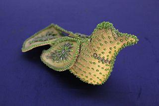 Folk Art Beaded Green Bird Figure