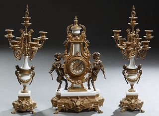 Louis XVI Style Ormolu Bronze and Marble Three Piece Mantel Clock Set, late 20th c., by Imperial, with a gilt bronze and marble urn surmount, over an