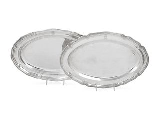 A Near Pair of German Silver Serving Platters