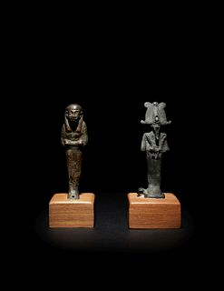 An Egyptian Bronze Ushabti and an Egyptian Bronze Osiris Height of taller example 3 inches; height of shorter example 2 7/8 inches.