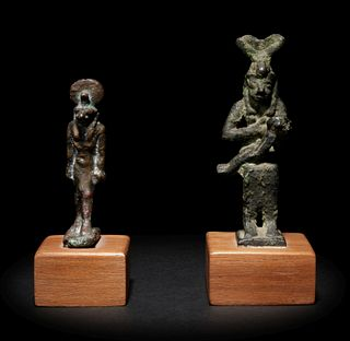 An Egyptian Bronze Anubis and an Egyptian Bronze Isis and Horus Height of taller example 3 1/8 inches; height of shorter example 2 1/2 inches.