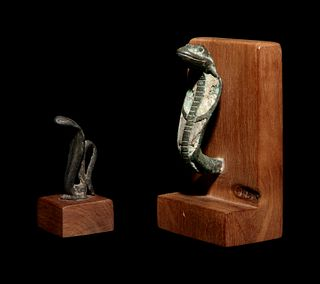 Two Egyptian Bronze Uraeus Finials Height of taller example 3 1/8 inches; height of shorter example 2 1/8 inches.
