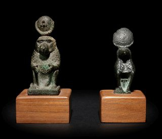 Two Egyptian Bronze Thoth Baboons Height of taller example 2 3/8 inches; height of shorter example 2 1/16 inches.