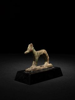 An Egyptian Bronze Wepwawet Height 2 3/8 x length 3 inches.