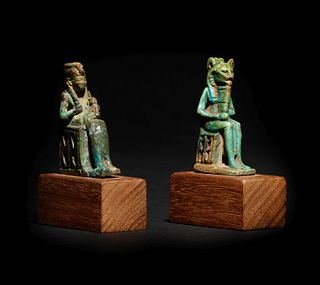 An Egyptian Faience Isis and Horus and an Egyptian Faience Sekhmet  Height of taller example 2 1/8 inches; height of shorter example 2 inches.